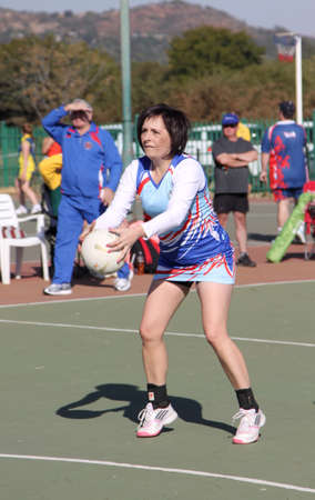 rustenburg: RUSTENBURG, SOUTH AFRICA - June 6:  Korfball League games played at Olympia Park on June 6, 2015 in Rustenburg South Africa.  Ladies team:  Girl goal trowing ball at net. Editorial