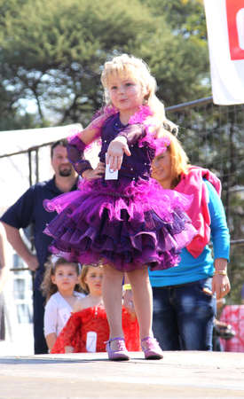 africa kiss: THABAZIMBI, SOUTH AFRICA - JUNE 28: Little Blond Angel in purple dress at Beauty Pageant at Wildsfees (Game Festival) on June 28, 2014 in Thabazimbi South Africa.