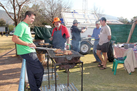 barbequing: THABAZIMBI, SOUTH AFRICA - JUNE 28: Men barbequing kebabs at Wildsfees (Game Festival) on June 28, 2014 in Thabazimbi South Africa.