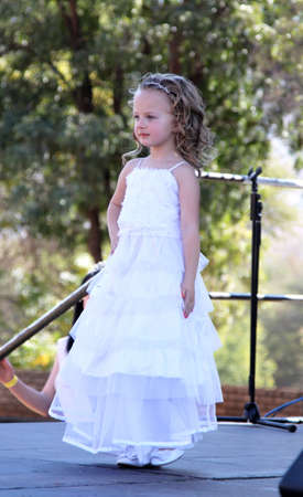 pageant: THABAZIMBI, SOUTH AFRICA - JUNE 28: Little Angel in white dress at Beauty Pageant at Wildsfees (Game Festival) on June 28, 2014 in Thabazimbi South Africa.