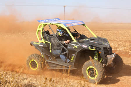 seater: BRITS, SOUTH AFRICA - July 11:  Africa-Offroad Racing Rally,  on July 11, 2015 at Koster, North West Province, South Africa.  Custom twin seater rally buggy kicking up trail of dust on sand track during rally race. Editorial