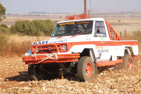 south africa soil: BRITS, SOUTH AFRICA - July 11:  Africa-Offroad Racing Rally,  on July 11, 2015 at Koster, North West Province, South Africa.  Drifting white Toyota Landcruiser truck kicking up dust on turn ar rally.