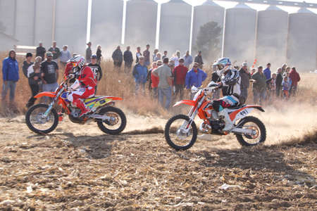 scrambler: BRITS, SOUTH AFRICA - July 11:  Africa-Offroad Racing Rally,  on July 11, 2015 at Koster, North West Province, South Africa.  Two motorbikes kicking up trail of dust on sand track during rally race.