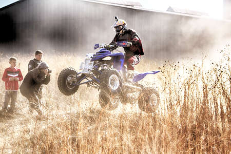 KOSTER, SOUTH AFRICA - July 11:  Africa-Offroad Racing Rally,  on July 11, 2015 at Koster, North West Province, South Africa.  HD - Quad Bike ramping in dust on sand track during rally race.
