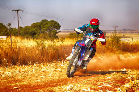 scrambler: KOSTER, SOUTH AFRICA - July 11:  Africa-Offroad Racing Rally,  on July 11, 2015 at Koster, North West Province, South Africa.  HD - Motorbike kicking up trail of dust on sand track during rally race.