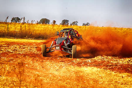 seater: KOSTER, SOUTH AFRICA - July 11:  Africa-Offroad Racing Rally,  on July 11, 2015 at Koster, North West Province, South Africa.  HD - Custom single seater rally buggy kicking up trail of dust on sand track during rally race. Editorial