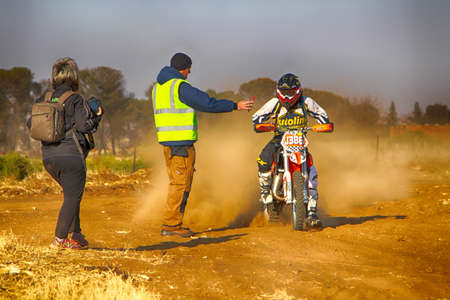 scrambler: KOSTER, SOUTH AFRICA - July 11:  Africa-Offroad Racing Rally,  on July 11, 2015 at Koster, North West Province, South Africa.  HD - Motorbike stopping at checkpoint on sand track during rally race.