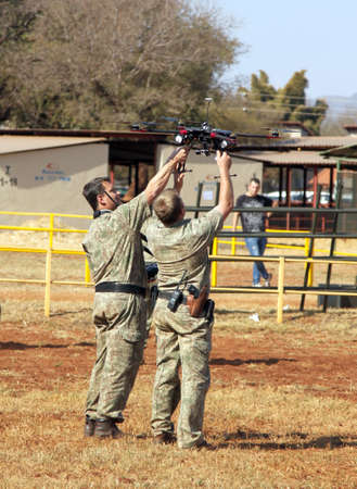 policing: THABAZIMBI, SOUTH AFRICA - August 1:  Farm Community Security displaying state of the art drone with camera to trace thieves and attackers at the Thabazimbi Agricultural Show, on August 1, 2014 at Thabazimbi, South Africa.