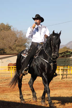 steed: THABAZIMBI, SOUTH AFRICA - August 1:  Thabazimbi Agricultural Show, on August 1, 2014 at Thabazimbi, South Africa. Armand the singing cowboy on his black stallion. Editorial