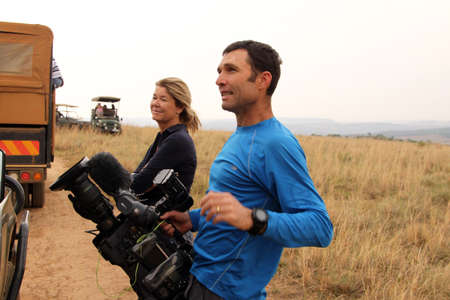poach: MAGALIESBERG, SOUTH AFRICA - October 14: Dehorning of rhinos in Askari Game Lodge, to protect them against poachers on October 14, 2015 at Magaliesberg, South Africa.  Alex Crawford and cameraman from Sky News, covering the event.