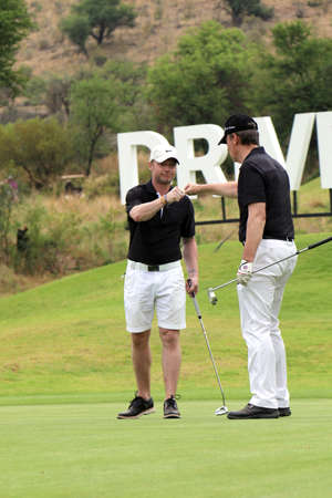 birdie: KEATING, RONAN - NOVEMBER 15: Singer-songwriter Ronan Keating at Gary Player Charity Invitational Golf Tournament proudly being congratulated with his birdie on November 15, 2015, Sun City, South Africa.
