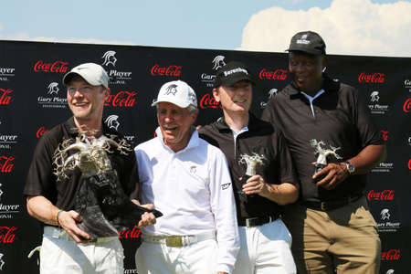 sello: WINNING TEAM - NOVEMBER 15: Ronan Keating, Gary Player, Dr. Hans-Walter Peters and Sello Moloko winners by 11 strokes at Gary Player Charity Invitational Golf Tournament on November 15, 2015, Sun City, South Africa.