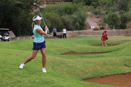 montgomery: MONTGOMERY, DANIELLA - NOVEMBER 15: Pro Golfer Playing at Gary Player Charity Invitational Golf Tournament playing over a bunker on November 15, 2015, Sun City, South Africa.