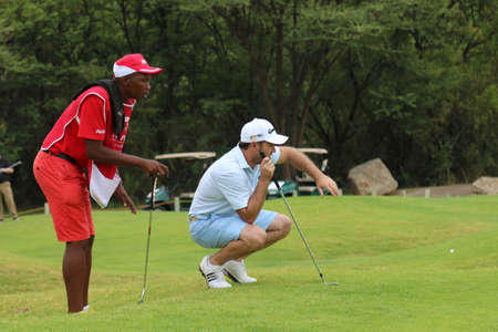 richard: STERNE, RICHARD - NOVEMBER 15: Pro Golfer Playing at Gary Player Charity Invitational Golf Tournament  sizing up his put on November 15, 2015, Sun City, South Africa. Editorial