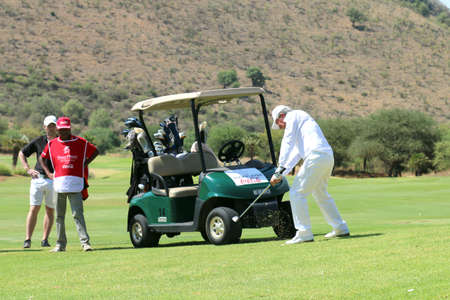 80 year old: PLAYER, GARY - NOVEMBER 15: Tournament presenter and grand master Gary Player Playing at Gary Player Charity Invitational Golf Tournament playing the perfect drop shop at the 18th on November 15, 2015, Sun City, South Africa.