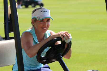 montgomery: MONTGOMERY, DANIELLA - NOVEMBER 15: Pro Golfer Playing at Gary Player Charity Invitational Golf Tournament behind steering wheel of golf cart on November 15, 2015, Sun City, South Africa.