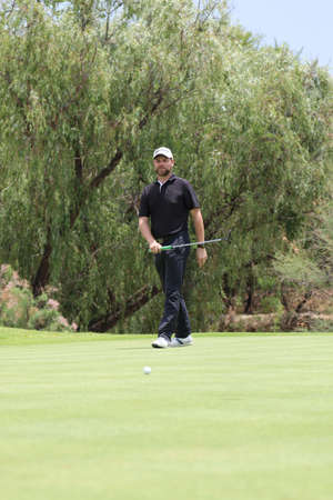 encouraging: MCFADDEN, BRIAN - NOVEMBER 15: Singer-songwriter and TV presenter Playing at Gary Player Charity Invitational Golf Tournament encouraging his ball on the green on November 15, 2015, Sun City, South Africa.