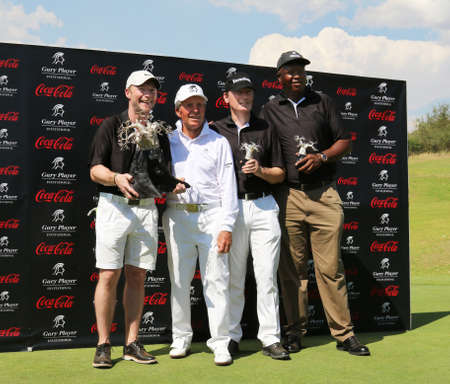 dr: WINNING TEAM - NOVEMBER 15: Ronan Keating, Gary Player, Dr. Hans-Walter Peters and Sello Moloko winners by 11 strokes at Gary Player Charity Invitational Golf Tournament on November 15, 2015, Sun City, South Africa.