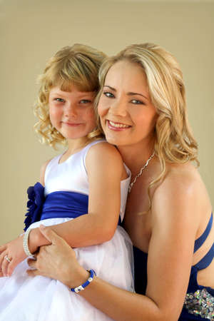 formal portrait: Lovely blond mom and daughter studio photo