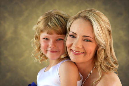alike: Lovely blond mom and daughter studio photo