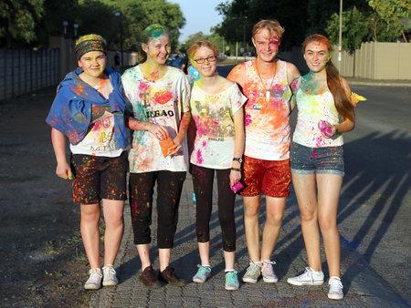 rustenburg: Rustenburg Marathon Club Rainbow Run - NOVEMBER 25: Lovely teens covered in powder paint posing for picture at colour run on November 25, 2015, Rustenburg, South Africa.