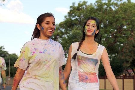 rustenburg: Rustenburg Marathon Club Rainbow Run - NOVEMBER 25: Two Chearful running young Indian girls covered with powder paint at colour run on November 25, 2015, Rustenburg, South Africa.