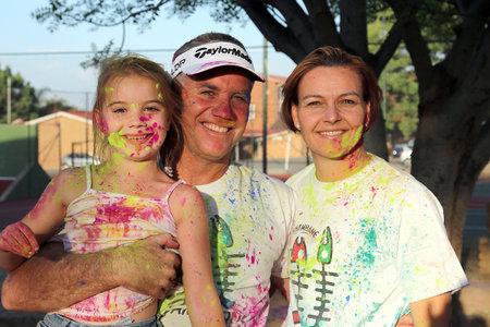 rustenburg: Rustenburg Marathon Club Rainbow Run - NOVEMBER 25: Lovely family covered in powder paint posing for picture on November 25, 2015, Rustenburg, South Africa.