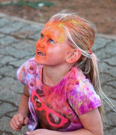 rustenburg: Rustenburg Marathon Club Rainbow Run - NOVEMBER 25: Beautiful young blond girl covered with powder paint at colour run on November 25, 2015, Rustenburg, South Africa.