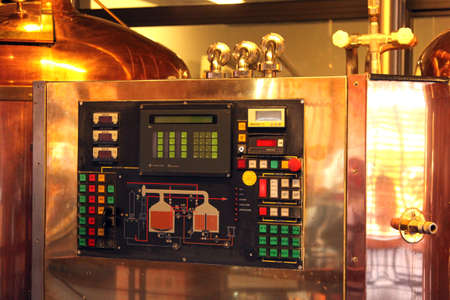 hobs: Kroondal, South Africa– JULY 25: North West Winter Craft Beer Festival held at Brauhaus am Damm, July 25, 2015. Modern craft automated copper beer brewing kettle electronics.
