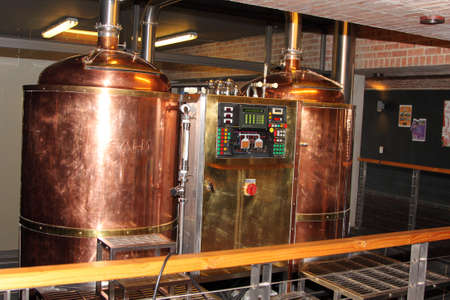 hobs: Kroondal, South Africa– JULY 25: North West Winter Craft Beer Festival held at Brauhaus am Damm, July 25, 2015. Modern craft automated copper beer brewing kettle.