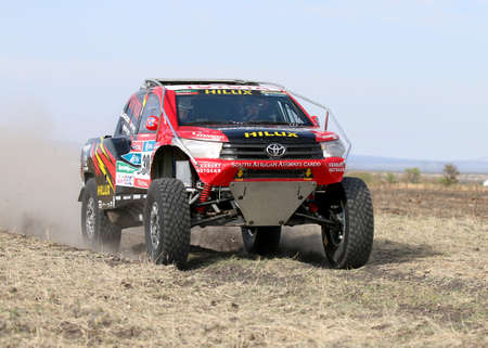 off road racing: Sun City, South Africa OCTOBER 1, 2016: Dakar legends Giniel de Villiers and navigator, Dirk von Zitzewitz testing the new Toyota Hilux Evo 2 wheel drive for the 2017 Dakar. Editorial