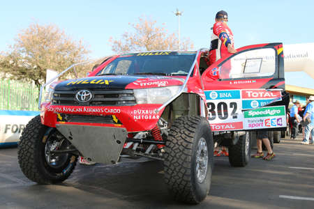 off road racing: Sun City, South Africa - OCTOBER 1, 2016: Dakar legends Giniel de Villiers and the new Toyota Hilux Evo 2 wheel drive they are testing for the 2017 Dakar. Editorial