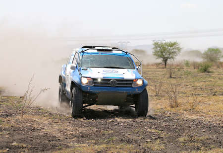 vw: Sun City, South Africa - OCTOBER 1, 2016: Front view of blue and white VW Amarok twin cab rally car racing through bush at Sun City 450 Rally Racing event, Sun City, South Africa Editorial