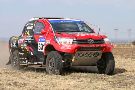 Sun City, South Africa - OCTOBER 1, 2016: Forty Five degree close-up view of Speeding red and black Toyota Hilux twin cab rally car in race at Sun City 450 Rally Racing event, Sun City, South Africa Editorial