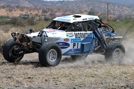 Sun City, South Africa - OCTOBER 1, 2016: Side view of white Zarco rally car racing through bush at Sun City 450 Rally Racing event, Sun City, South Africa Editorial