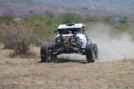 Sun City, South Africa - OCTOBER 1, 2016: Front view of white Zarco rally car racing through bush at Sun City 450 Rally Racing event, Sun City, South Africa Editorial