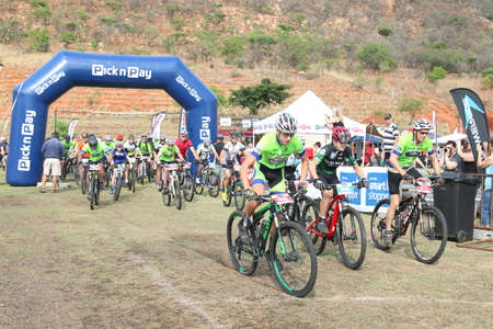 rustenburg: Rustenburg, South Africa - OCTOBER 23, 2016: Old and young riders at start of marathon 45km race at Mathaithai Mountain Bike Race, Rustenburg, South Africa.
