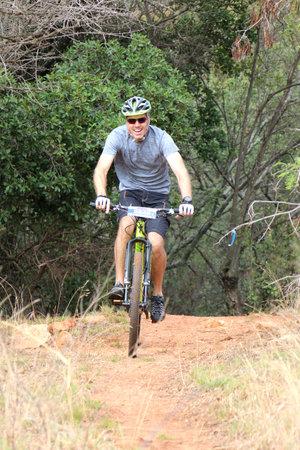 rustenburg: Rustenburg, South Africa - OCTOBER 23, 2016: Smiling man enjoying outdoors ride at Mathaithai Mountain Bike Race, Rustenburg, South Africa. Editorial