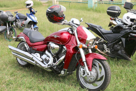 Rustenburg, South Africa - March 3, 2017: Parked red Suzuki Boulevard M109R motorbike on green grass at Yearly Mass Ride of Tainted Souls Motorbike Club, Rustenburg, South Africa.