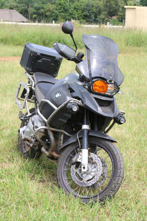 Rustenburg, South Africa - March 3, 2017: Parked large black BMW motorbike on green grass at Yearly Mass Ride of Tainted Souls Motorbike Club, Rustenburg, South Africa.