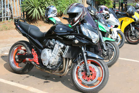 Rustenburg, South Africa - March 3, 2017: Parked motorbikes with Black Suzuki Racing bike at Yearly Mass Ride of Tainted Souls Motorbike Club, Rustenburg, South Africa. Editorial