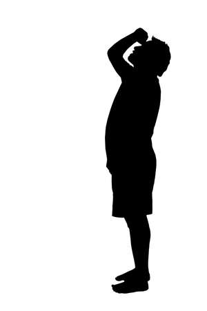 Side profile portrait silhouette of a barefoot man looking upward at high object