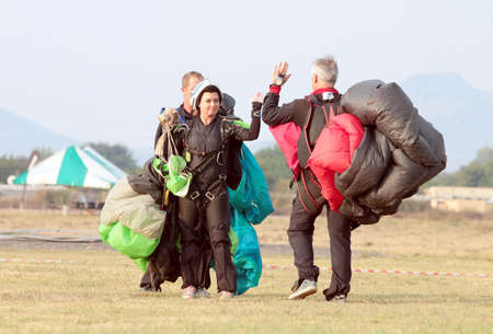 RUSTENBURG, SOUTH AFRICA - April 28, 2017: National Skydiving Championships. Skydiving team giving each other high five after successful artistic jump