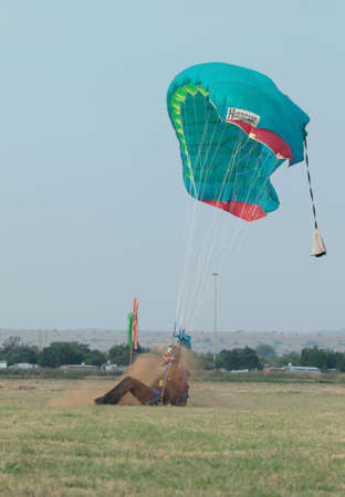 RUSTENBURG, SOUTH AFRICA - April 28, 2017: National Skydiving Championships. Skydiver making a hard landing with open parachute. Editorial