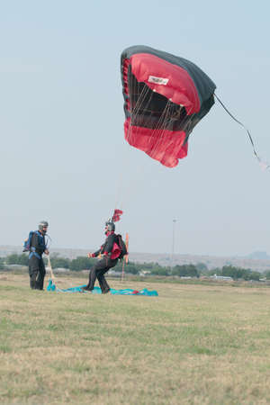 RUSTENBURG, SOUTH AFRICA - April 28, 2017: National Skydiving Championships. Skydiver landing next to another with open parachute.