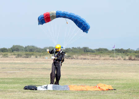 RUSTENBURG, SOUTH AFRICA - April 28, 2017: National Skydiving Championships.  Landed skydiver looks as though he has extra small chute (other diver landing behind him)