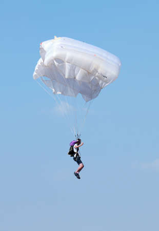 RUSTENBURG, SOUTH AFRICA - April 28, 2017: National Skydiving Championships. Jumper with white open parachute gliding in for landing. Editorial