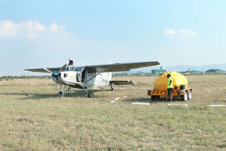 RUSTENBURG, SOUTH AFRICA - April 28, 2017: National Skydiving Championships.  X328 Atlas Angel Turbine specially equipped aircraft for sky divers being fuelled up from mobile fuelling tank.