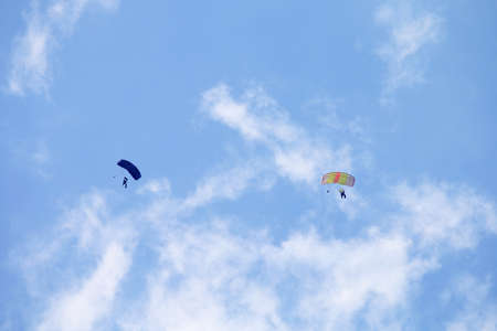 RUSTENBURG, SOUTH AFRICA - April 28, 2017: National Skydiving Championships. Two skydivers with colourful chutes circling in queue for landing. Editorial