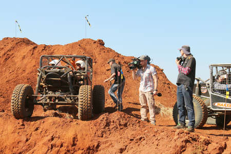 Rustenburg, South Africa – JUNE 17, 2017: National Extreme Modified 4x4 Vehicle Championship. Car waiting to descent into dugout dugout with press standing by.